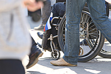 disabled people in the crowd, feet