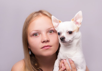 Portrait of the beautiful girl with chihuahua