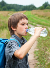 Kid drinking water oudoors