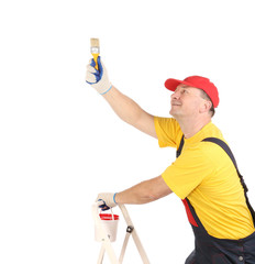 Worker on ladder with brush.