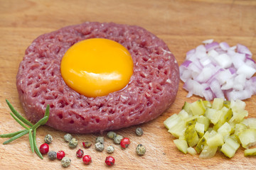 Beef raw tartare with yolk onion and cucumber
