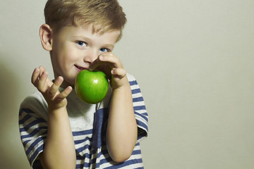 Smiling Child with Green apple.Little Handsome Boy.Health.Fruits