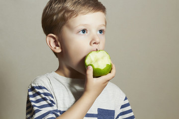 Funny Child eating apple.Little Boy. Health food. Fruits