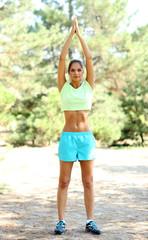 Young beautiful woman exercising outdoors