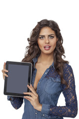 A young and happy girl holding a tablet computer isolated