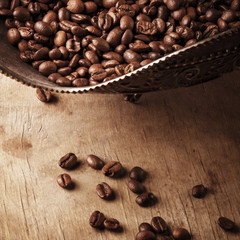 Coffee in bowl on grunge wooden background