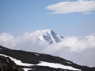 peaks of mountains in the clouds, Russia, Kamchatka