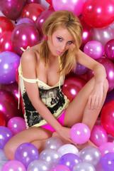Sexy attractive girl posing with balloons