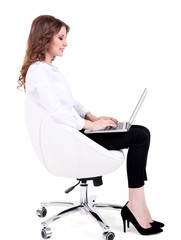 Young business woman sitting