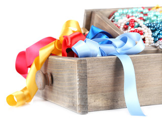 Grey drawer full of multicoloured ribbons and beads