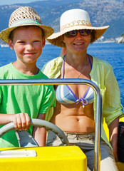 Mother with her son in a motorboat.