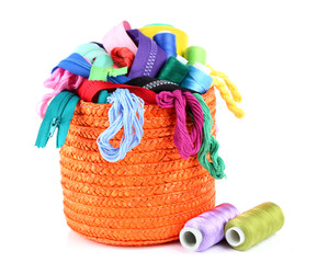 Round orange box full of multicoloured threads and everything