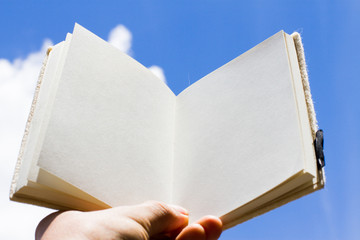 open book and sky background