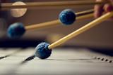 Sticks hitting a xylophone closeup