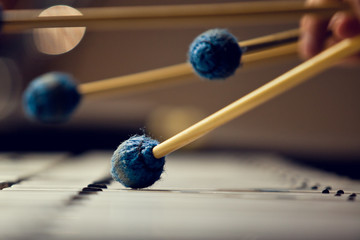 Sticks hitting a xylophone closeup