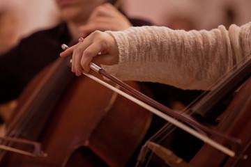 Hand girl playing cello closeup