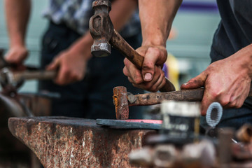 Horse shoe being made by blacksmith
