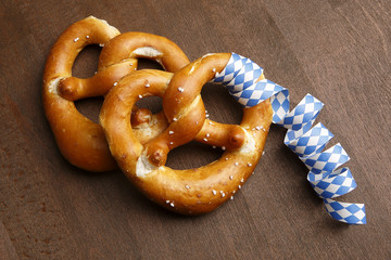 Two typical bavarian pretzel with white and blue streamer