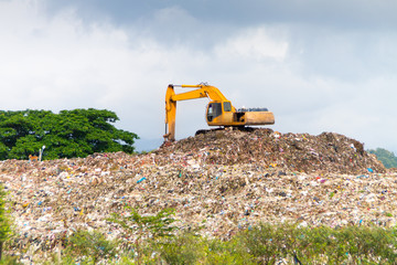 Landfill truck working on dumpsite