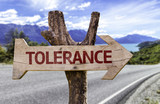 Tolerance ooden sign on a street on background poster
