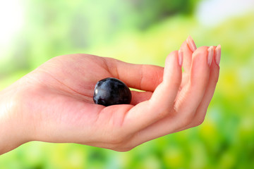 Purple grape in hand on natural background