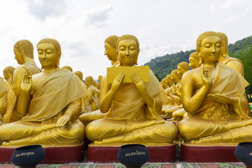 golden statue of buddhist saint