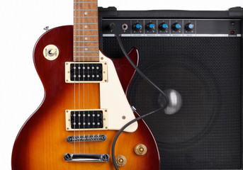 Amplifier and Guitar on White