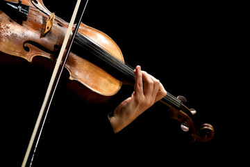 Hand of a woman playing the violin on a black background