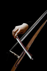 Hand girl playing cello on a black background