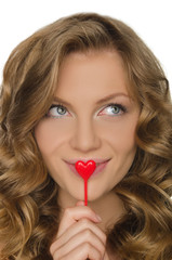 young woman holding heart in front lip