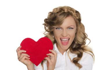 young woman holding heart next to him