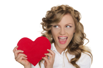 woman holding heart next to him and looks away