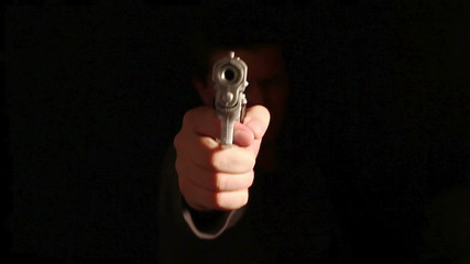 3CLIPS: A man sharply raises his gun to the camera