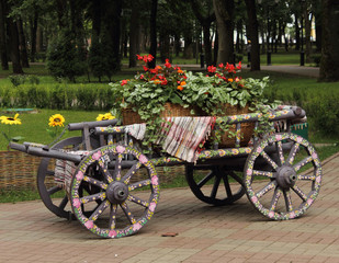 cart with flowers. The element of landscape design