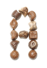 Alphabet letter A arranged from chocolate sweets isolated