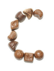 Alphabet letter C arranged from chocolate sweets isolated