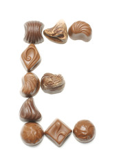 Alphabet letter E arranged from chocolate sweets isolated