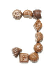 Alphabet letter J arranged from chocolate sweets isolated