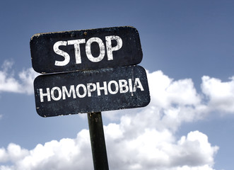 Stop Homophobia sign with clouds and sky background