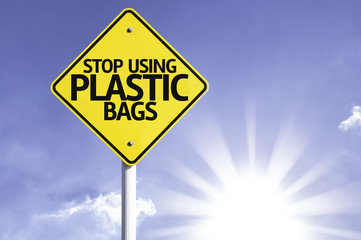 Stop Using Plastic Bags road sign with sun background