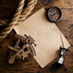 Old compass, astrolabe and rope