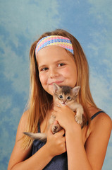 Pretty girl with little kitten