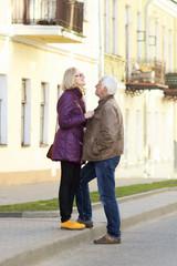 Beautiful mature couple walking along the city streets