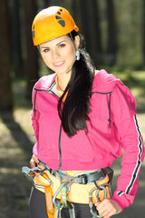 Portrait of beautiful girl in climbing gear