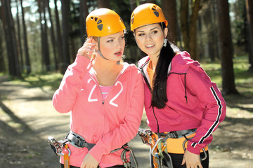 Portrait of two beautiful girls in climbing gear