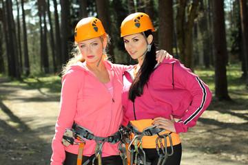 Portrait of two beautiful girls in climbing gear