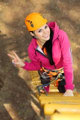 Beautiful girl climber climbs up the stairs