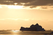 Iceberg in Antarctic waters in the rays of the setting sun on a