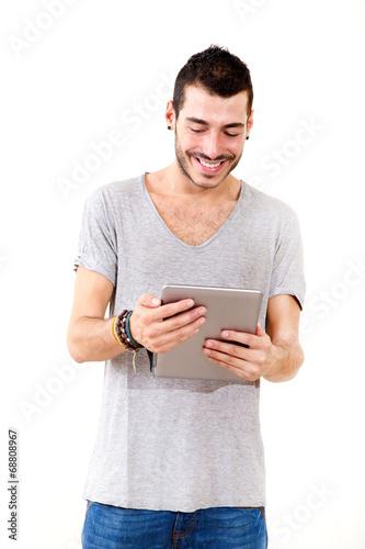 canvas print picture Junger Mann mit Tablet Pc