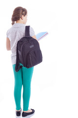 Rear view of a school girl with backpack holding notebooks, isol